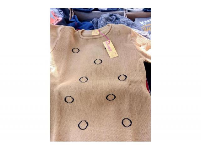 stock abbigliamento da bambino/a